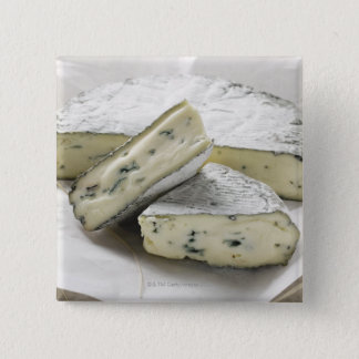 Blue cheese with pieces cut on paper button