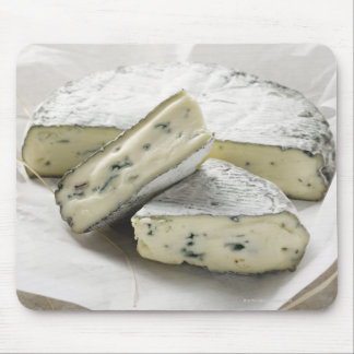 Blue cheese with pieces cut on paper mouse pad