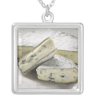 Blue cheese with pieces cut on paper silver plated necklace