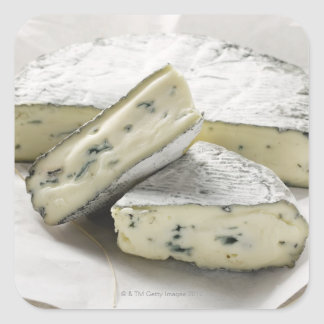 Blue cheese with pieces cut on paper square sticker