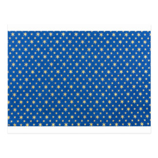 Blue cloth with golden stars for christmas postcard