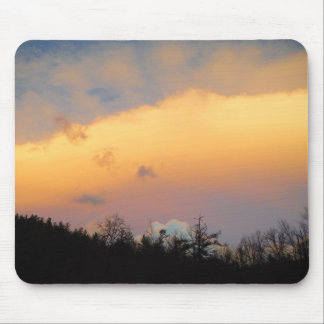 Blue clouds in a lavender sky mouse pad