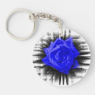 Blue color rose against black burst frame round acrylic keychains