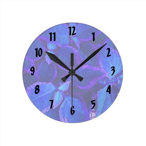 Blue colorized plant coleus round clock