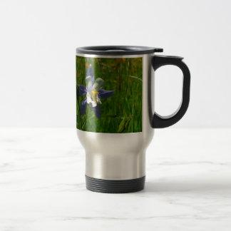 Blue columbine in field travel mug