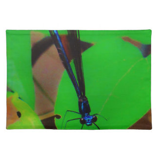 Blue Damselfly on a green leaf dragon Place Mats