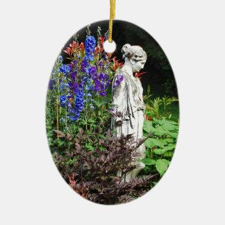 Blue delphinium flower garden and statue ceramic ornament