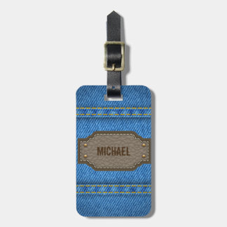 Blue denim jeans with leather name label luggage tag