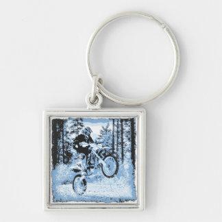 blue dirtbike wheeling in woods1 12x keychain