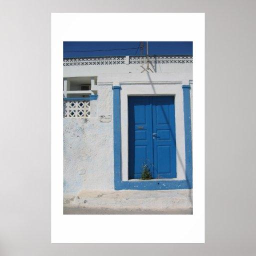 Blue door in Santorini Poster