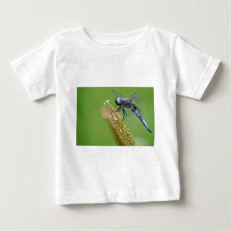 Blue dragonfly on grass shirt