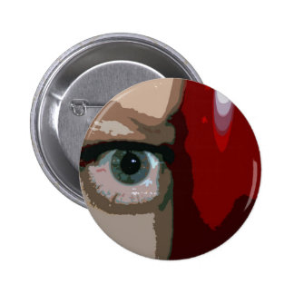 Blue eye from behind red bass close up 2 inch round button