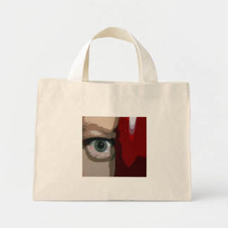 Blue eye from behind red bass close up canvas bags