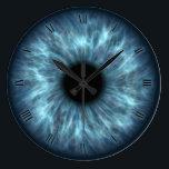 "Blue eyes iris eyeball wall clock<br><div class=""desc"">Cute fun blue eyeball on wall clock with roman numbers</div>"