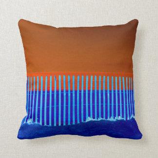 blue fence blue sand orange sky florida beach pillow