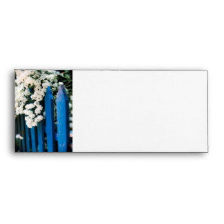 Blue fence with white flowers envelopes