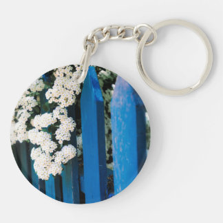 Blue fence with white flowers keychain