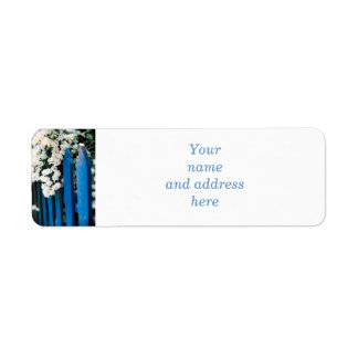 Blue fence with white flowers label