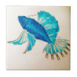 """Blue Fish Watercolor Tile<br><div class=""""desc"""">This unique aquatic design was originally painted by an artist using watercolors. It is perfect for anybody who loves nature,  the sea,  or fish! All royalty profits from purchases will directly support the painter.</div>"""