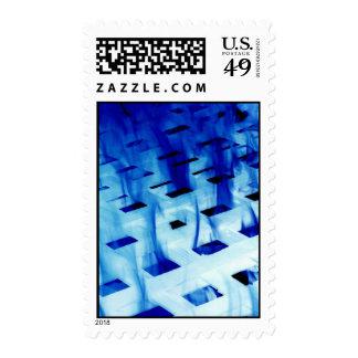 Blue flames through white grid design photo postage