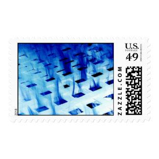 Blue flames through white grid design photo postage stamp