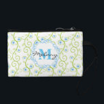 """Blue Floral Print Monogram Coin Wallet<br><div class=""""desc"""">This delicate and feminine design features a floral print in blue and green with a decorative monogram frame and personal monogram. Personalize with your monogram by selecting the &quot;Customize It&quot; button and entering your text into the design template. You may change the fonts and font sizes to accommodate the size...</div>"""