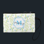 "Blue Floral Print Monogram Coin Wallet<br><div class=""desc"">This delicate and feminine design features a floral print in blue and green with a decorative monogram frame and personal monogram. Personalize with your monogram by selecting the &quot;Customize It&quot; button and entering your text into the design template. You may change the fonts and font sizes to accommodate the size...</div>"