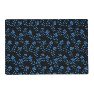 Blue flower branches on black placemat