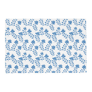 Blue flower branches on white placemat