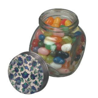 Blue flower motif pattern white background glass jar
