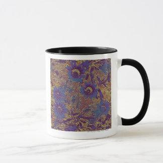 Blue flowers against leaf camouflage pattern mug