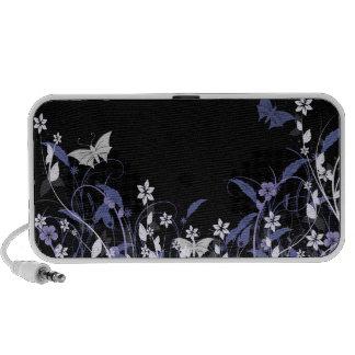 Blue flowers and butterflies on black travelling speakers