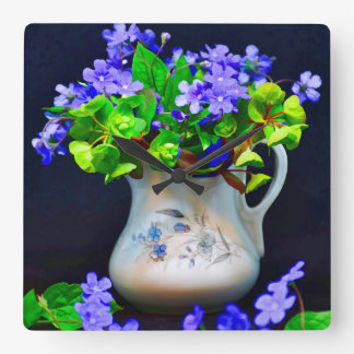 Blue flowers in vase. square wall clock