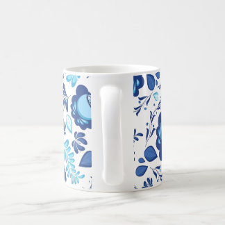 Blue flowers pattern on white background coffee mug