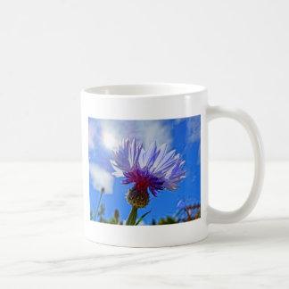 blue garden cornflower in sunlight coffee mug