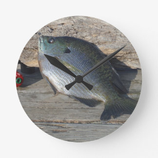 Blue Gill on the Dock Round Wall Clocks