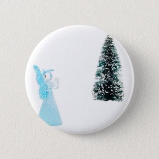 Blue glass angel praying near christmas tree button