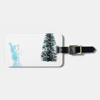 Blue glass angel praying near christmas tree luggage tag