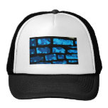 Blue glass chunks with black grout between them trucker hat