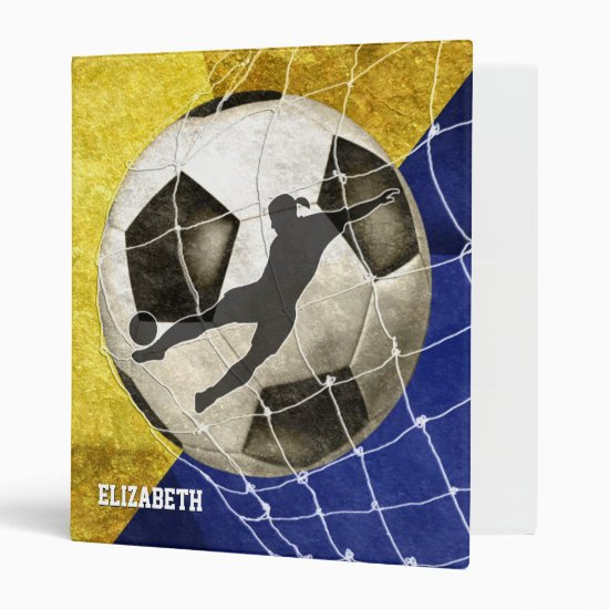 blue gold women's soccer player kicking goal binder