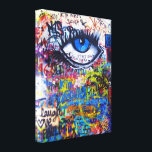 """Blue graffiti evil eye canvas print<br><div class=""""desc"""">Cool modern  urban graffiti photo on a city wall,  in Prague with a blue evil eye and multicolored graffitied words and text.</div>"""