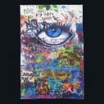 "Blue graffiti evil eye hand towel<br><div class=""desc"">Colorful distressed modern  urban graffiti photo on a city wall,  in Prague with a blue evil eye and multicolored graffitied words and text.</div>"