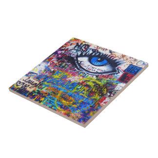 Blue graffiti evil eye tile