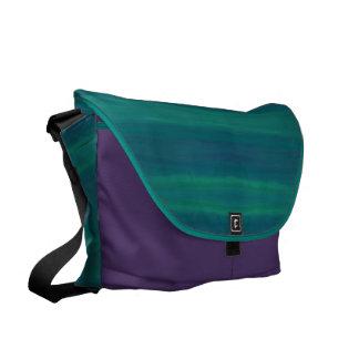 blue green purple striped messenger bag