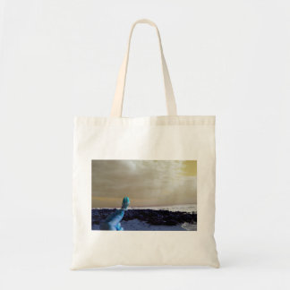 blue hand holding barnacle yellow sky tote bag