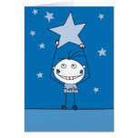 blue happy monster is catching a falling star greeting card