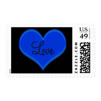 Blue heart with love postage on black