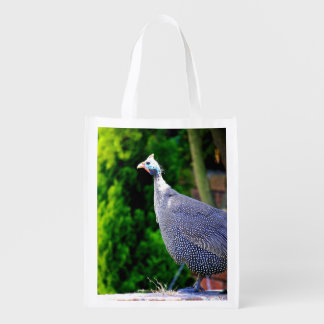Blue Helmeted Guinea Fowl standing in the sun Reusable Grocery Bag