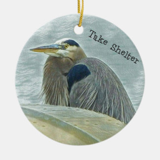blue heron sheltering from wind behind boat on lak ceramic ornament