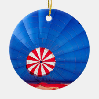 Blue Hot Air Balloon Inflating On The Ground Double-Sided Ceramic Round Christmas Ornament